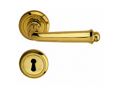 Siena Door Handle on Round Rose With Keyhole Covers With Spring in Brass for House Bal Becchetti